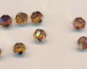 Twelve Swarovski crystals - Art. 5000 - 10 mm - light colorado topaz AB 2X
