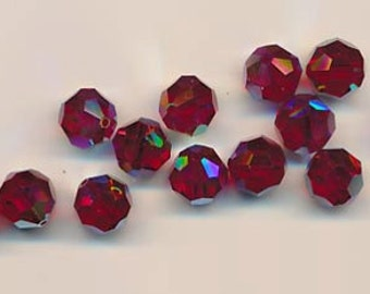 Twelve Swarovski crystals - Art. 5000 - 10 mm - siam red AB 2X