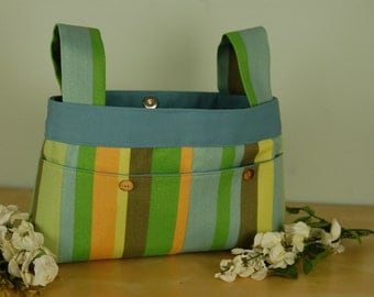 Walker Bag: Fresh and Lively Striped Bag in pastel shades of blue, green and yellow, with a light blue lining.