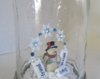 "snowglobe Jar  "" Secret Crazy Friend"" diorama in a mason jar with a fimo snowman,and bottle brush tree in the  crystal snow scene ooak"