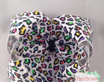 5 inch boutique style hair bow. Leopard neon print with glitter