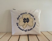 And there's magic in the sound of their name Notre Dame Zippered Bag