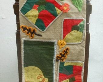 Patchwork hanging storage pocket in vivid colours