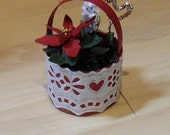 Christmas flowers in a basket with decoration