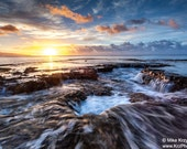 Water Flowing off a Rocky Shelf During Sunset at Shark's Cove, North Shore, Oahu, Hawaii