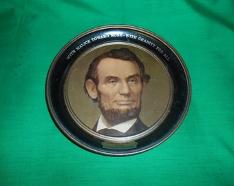"""One (1) 8 1/4"""" Circular Metal Tray, with Abraham Lincoln in the Center."""