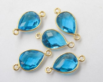 5 x gold framed crystal stone connectors 20mm x 10mm with loops, blue