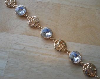 Gold Tone Link Bracelet with Clear Crystal and Gold Tone Charms