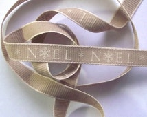 Rustic Christmas ribbon. Noel. Ivory on natural brown. Jute effect ribbon. 1.5cm wide x 3 metres long