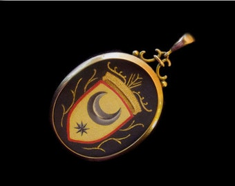 SOLD- Reserved For Susan-Next Payment-Sandra Hendler Original Miniature Painting of  Heraldic Shield With Moon & Star in Antique Gold Locket