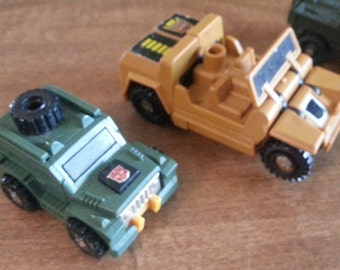 Pair of Vintage G1 Jeep Transformers