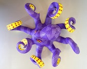 Spectacular purple octopus, carved and painted by hand