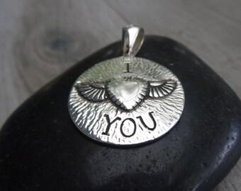 I love you !!! Sterling silver medallion.