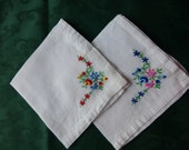 These two floral embroidery patterns on these hankies are very nicely done.  Tiny little stitches.