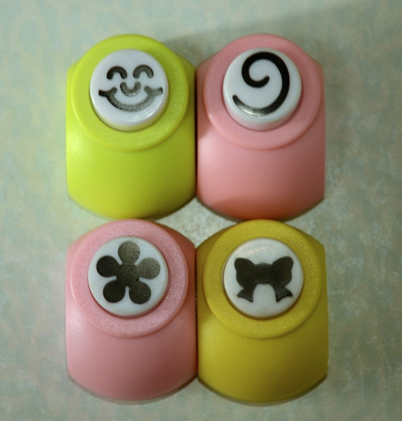 A Paper Punch (Pick 1): Expressive Face, Swirl, Flower, Or Ribbon
