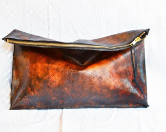 Fold over distressed leather clutch