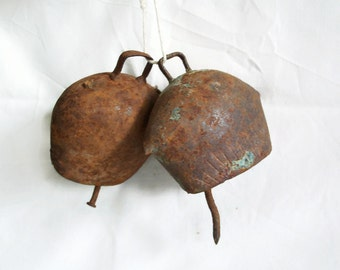 Cling Clang! Pair of rustic sheep or calf bells, primitive rusty nail clapper, vintage metal small cowbell. Country charm. Barn, ranch decor