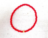 Antique gold cube bracelet with red seed beads