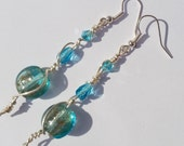 Earrings wire wrapped silver plated with turquoise aqua glass flat round glass beads with gold shimmer and crystals