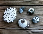 white and gray lotus moon painted stones