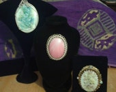 Three piece lot Pendant, and two Brooches hand painted flowers, signed