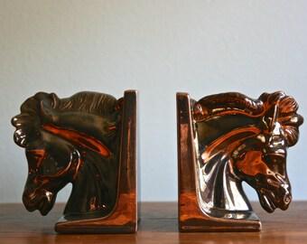 Vintage pair of glazed ceramic horse head book ends