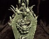 Crusted Cthulhu Casket - The Vulgar Tribute