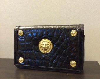 vintage black patent crocodile embossed clutch with gold lion details