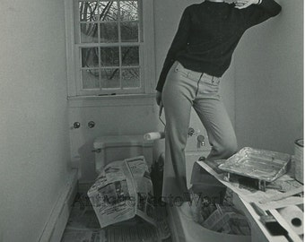 Woman painting a bathroom vintage art photo