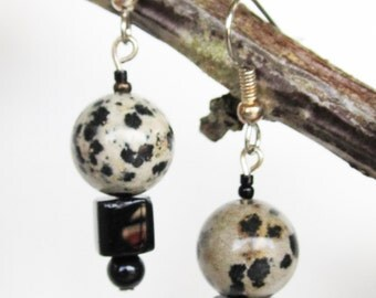 Black and taupe bead dangle earrings on steel wires