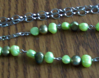 Irridescent olive and light green freshwater pearl necklace  unusual silver chain about 28 inches Classy