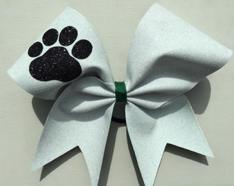 white glitter with black paw on dark green ribbon cheer bow. Ask about bulk discounts, color and mascot options.