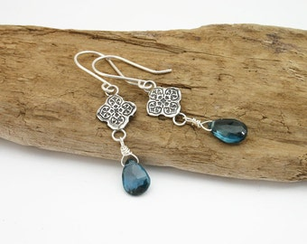 London blue topaz earrings. Sterling silver dangle earrings with london blue topaz briolette. Modern, unique, handmade December birthstone