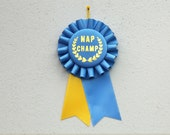 Nap Champ - Prize Ribbon Award Rosette / blue and golden yellow