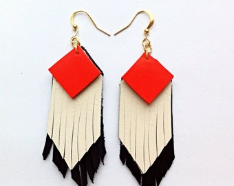 Fringed geometric tassel eco leather earrings, in Neon orange, white and black leather hand-cut layers