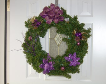 Purple Evergeen 24 In wreath, lite with LED battery powered lights