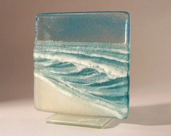 "Turquoise Seaside Upstand - The Small Wave - fused glass windowsill panel 12cm (3 3/4"") square on 1 foot"