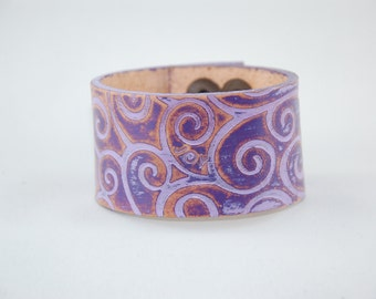 "Embossed ""Wear Your Word"" cuffs."