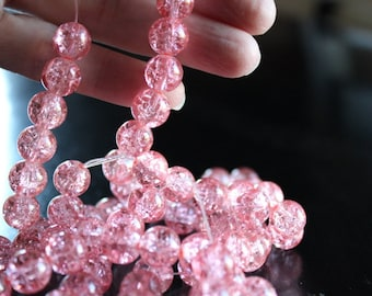 80 approx.light salomon 10 mm crackle glass beads, 1.5 mm hole, round and smooth, light reflective