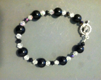 8 Inch Bracelet with 11mm Black Beads and 7mm Aurora Borealis and Black Crystal Spacers