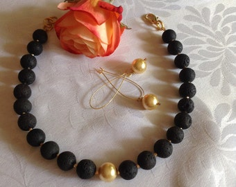 Wilma and Betty matte black lava stone and gold Swarovski pearl necklace (adjustable choker length) and earrings. 170/180