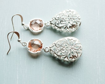 50% OFF Silver filigree tear drop and peach crystal dangle earrings. 1
