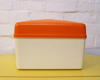 Vintage storage tub with orange lid