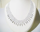 Netting necklace in white and grey with silvercouloured glascrystal, handmade, chic, elegant, festive