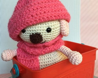 Amigurumi dog with pink hat and a scarf