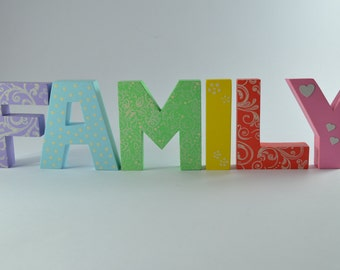 Written FAMILY in wood