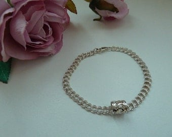 Sterling silver double curb charm bracelet with charm bead.