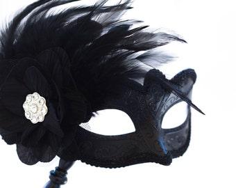 Black phantom masquerade mask with stick, Black masquerade mask with feathers and stick perfect for masquerade ball parties