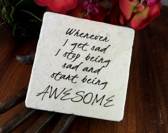 Whenever I get sad I stop being sad and start being awesome. Motivational quote on marble plaque.