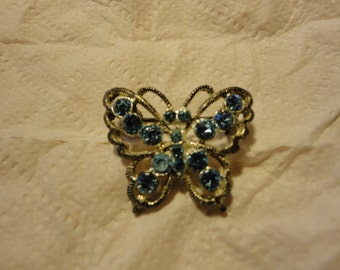 Tiny vintage blue butterfly brooch